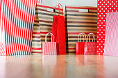 Assorted shopping and gift red paper bags