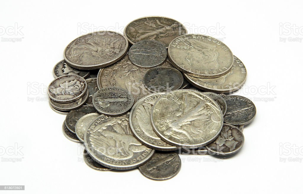 Assorted Silver Coins on White Background stock photo