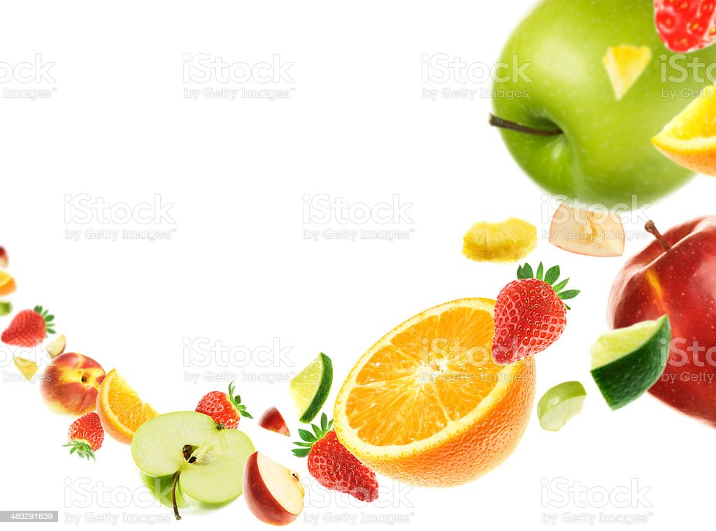 Assorted sliced fruits on white background stock photo