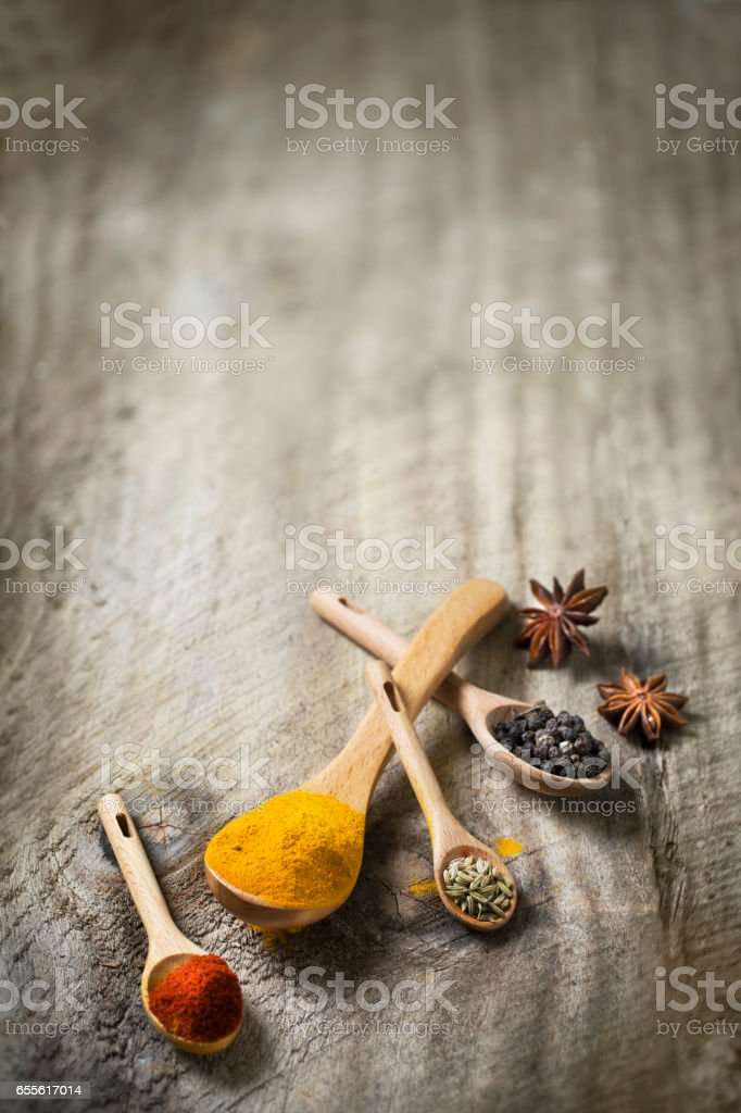 Assorted spice and dried herb in spoon. stock photo
