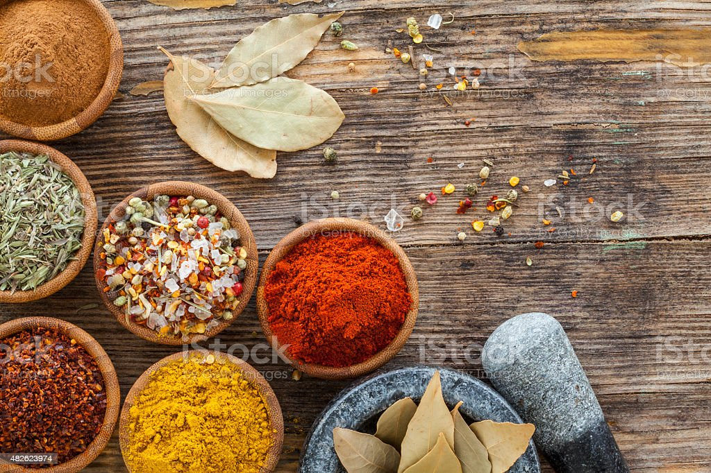 Assorted spices in bowl stock photo