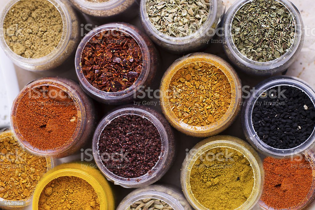 Assorted spices in containers royalty-free stock photo