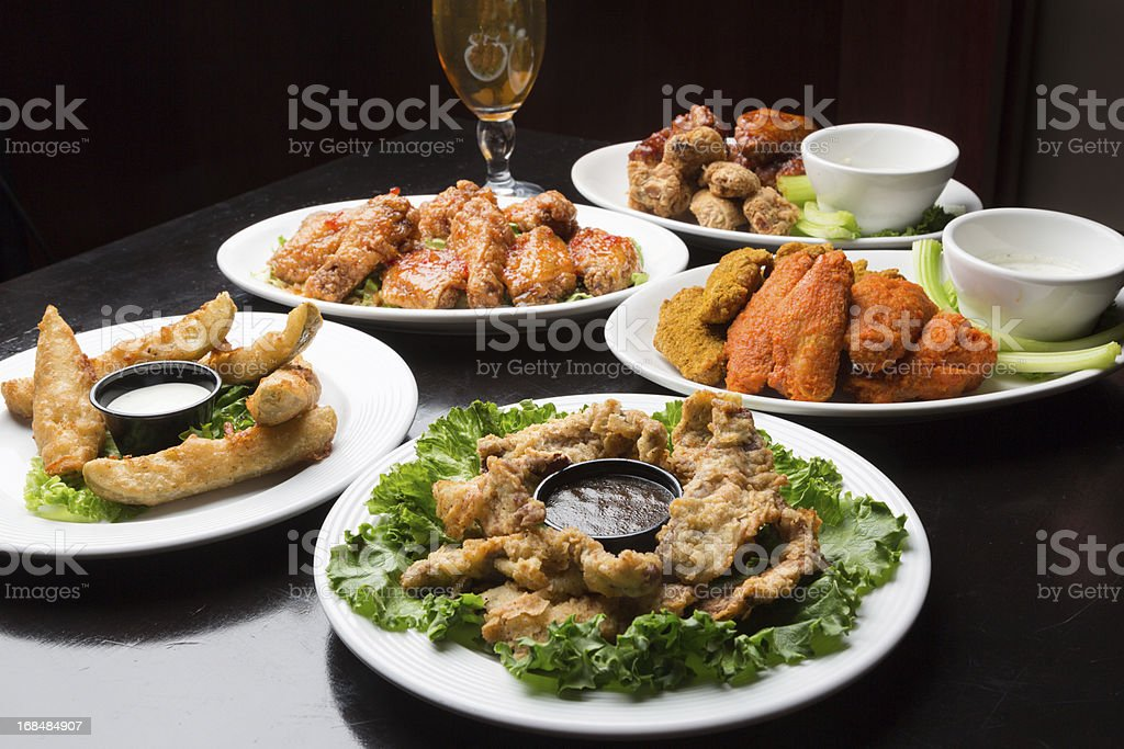 Assorted Spicy Chicken Wings and Beer royalty-free stock photo