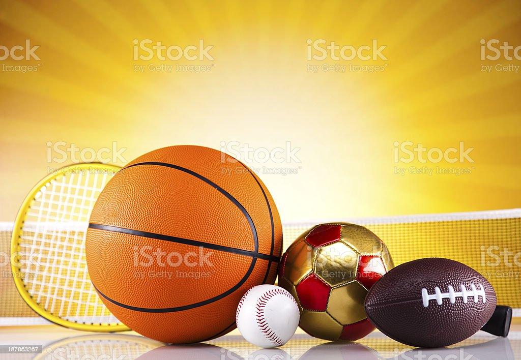 Assorted sports equipment and sunset royalty-free stock photo