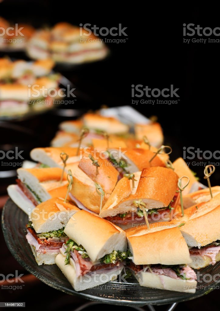 Assorted stacks of sandwiches against black background stock photo