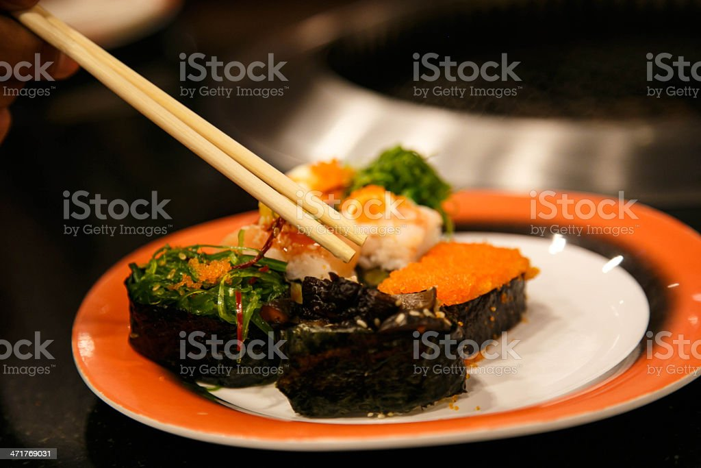 Assorted Sushi on orange plate royalty-free stock photo
