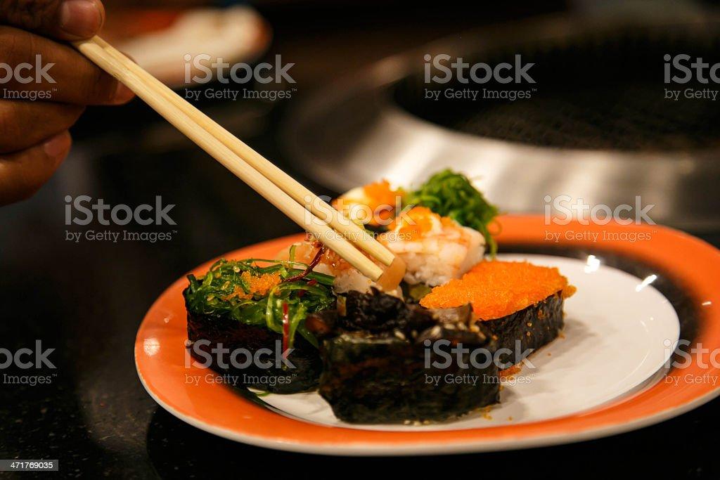 Assorted Sushi on orange plate royalty-free stock photo