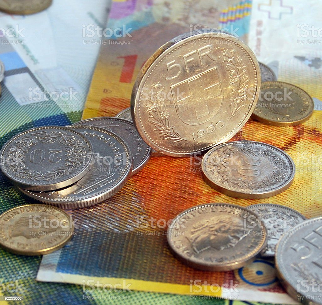 Assorted Swiss coin and paper francs stock photo
