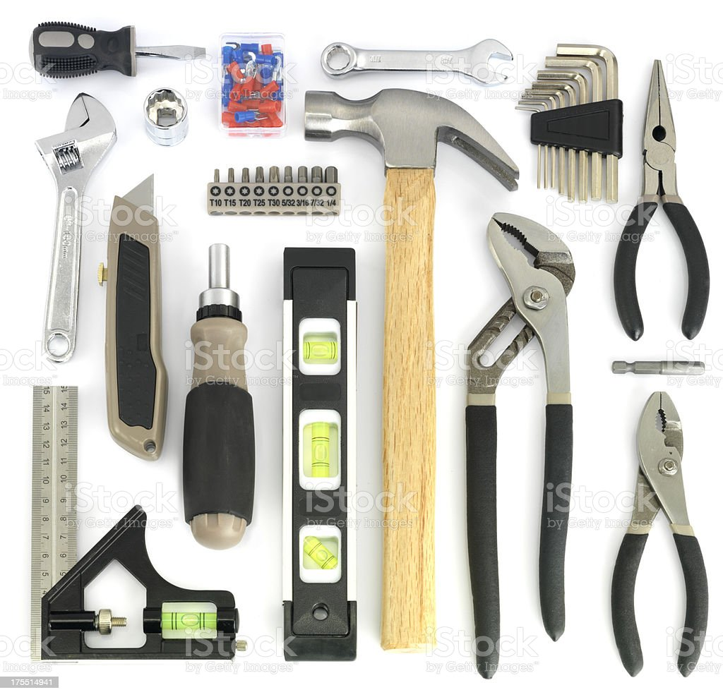 Assorted tools arranged on white background stock photo