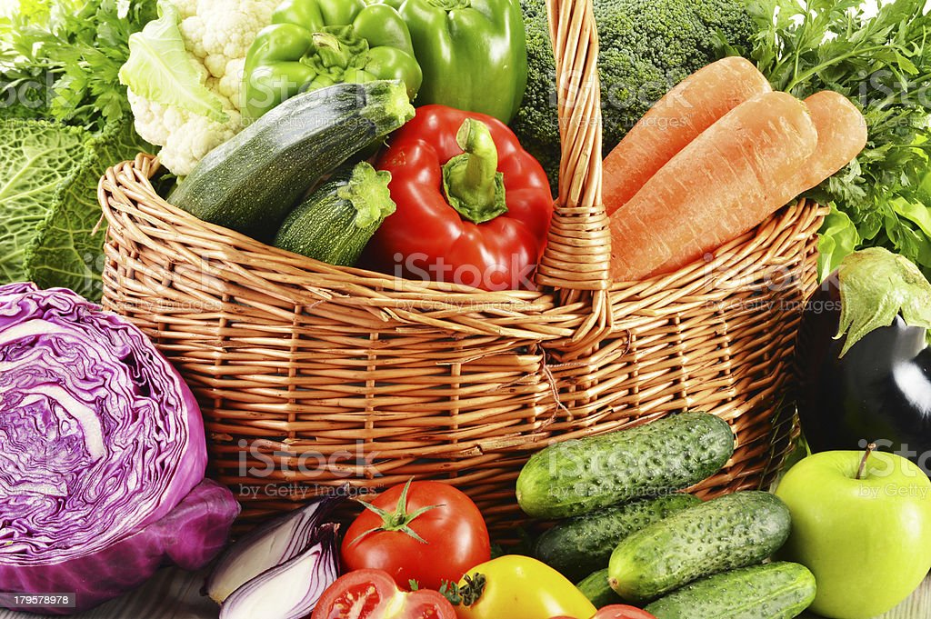 Assorted vegetables in wicker basket royalty-free stock photo
