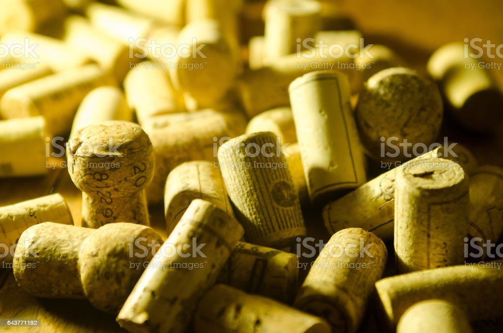 Assorted wine corks on wooden background stock photo