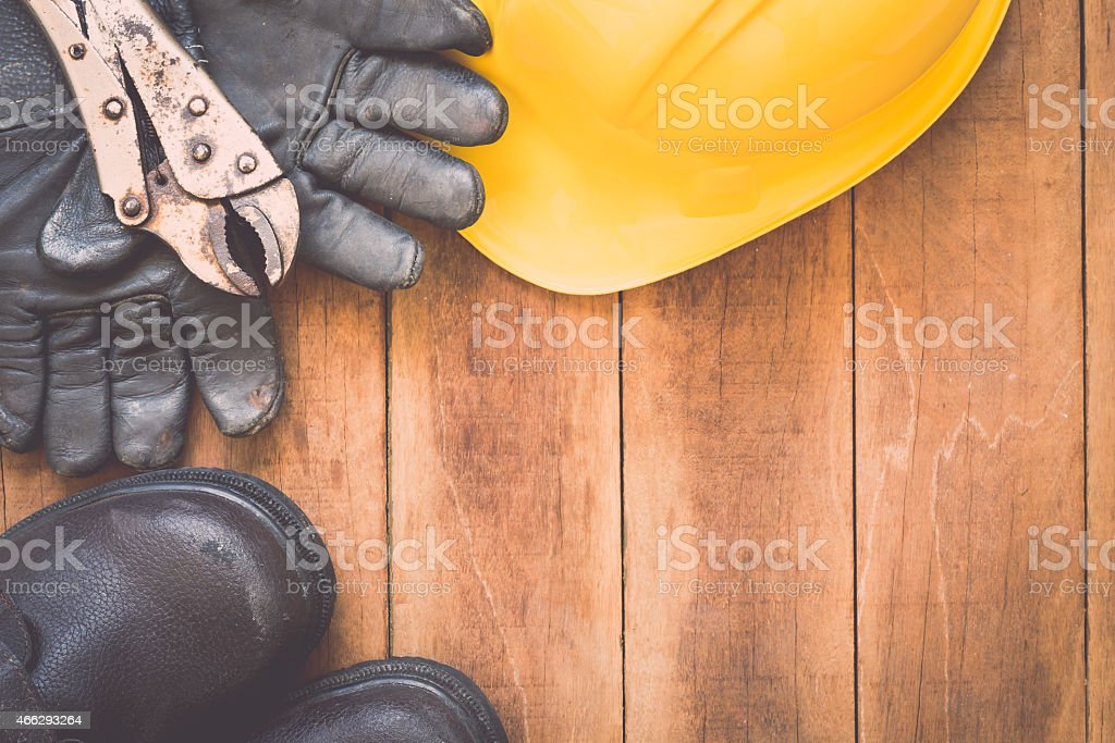Assorted work tools on wood stock photo