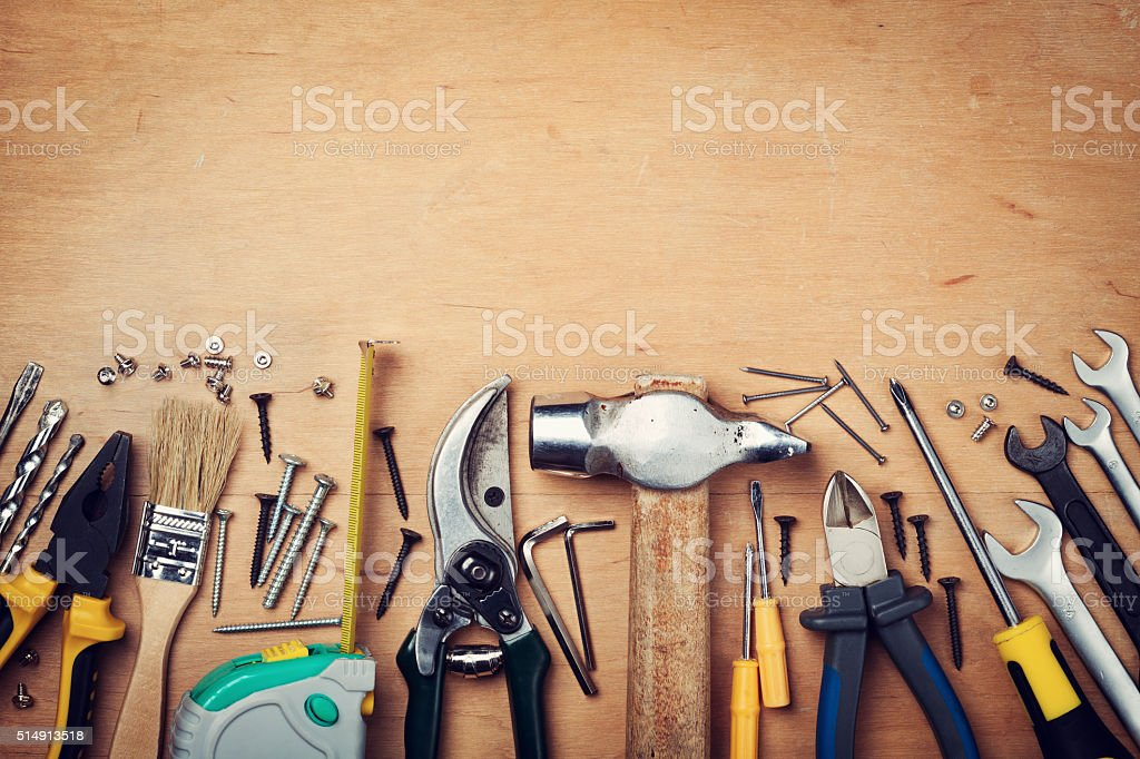 Assorted work tools on wood with copy space for text stock photo
