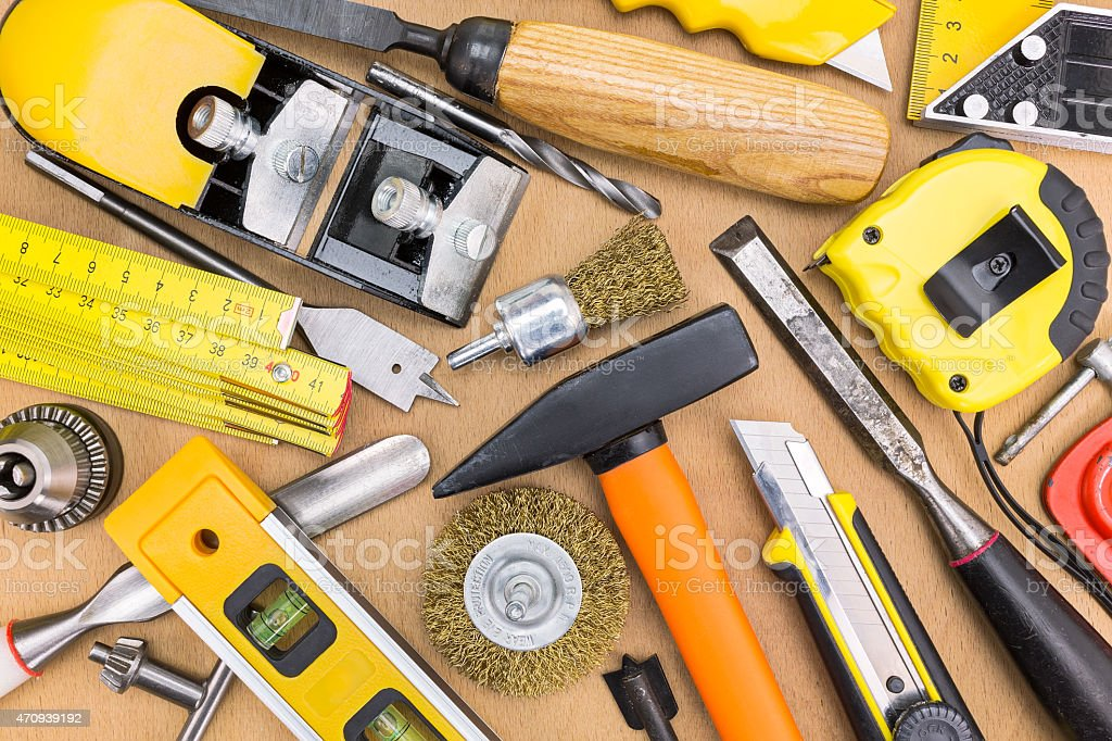 Assorted work tools on wooden background stock photo