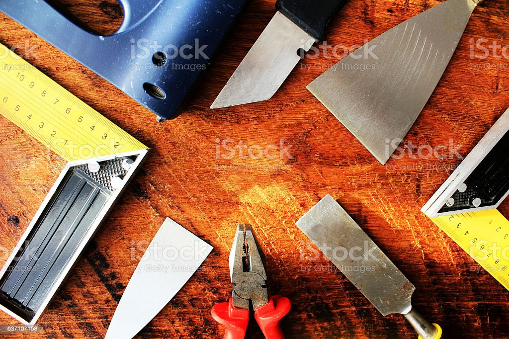 Assorted work tools on wooden background. Top view. stock photo