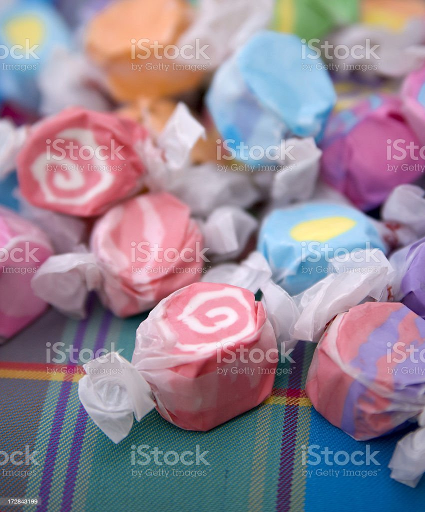 Assorted Wrapped Salt Water Taffy Candy Background on Picnic Blanket stock photo