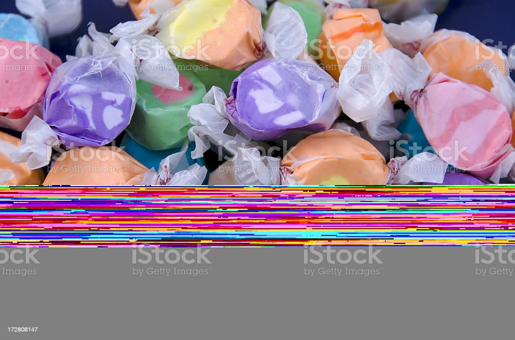 Assorted Wrapped Salt Water Taffy Candy, Sweet Food Background stock photo