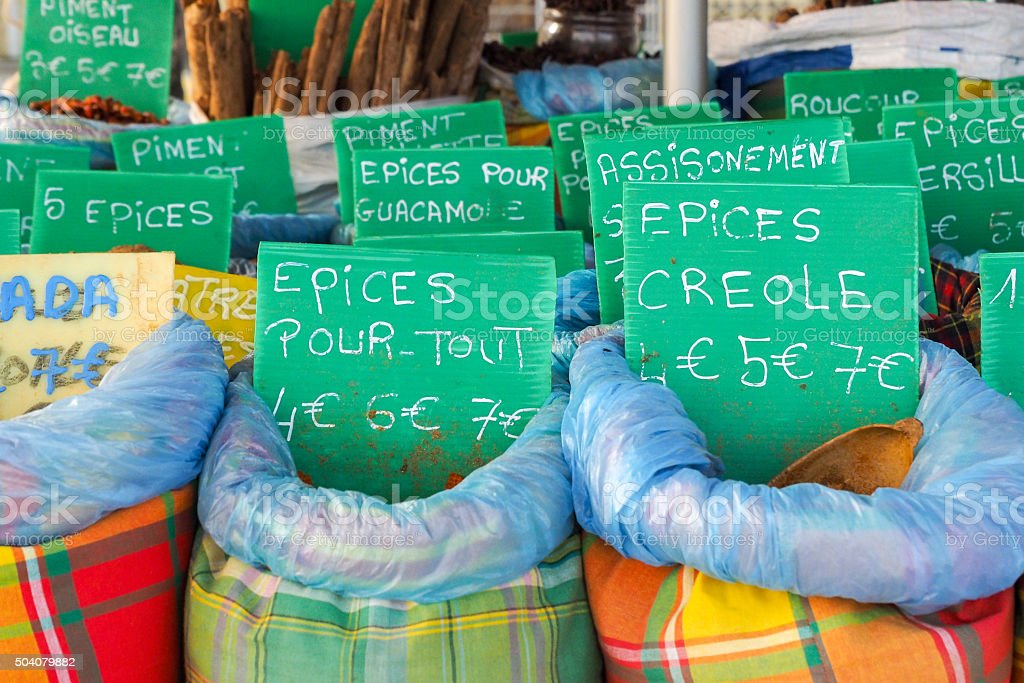 Assortment choice of spices, basket on market stall stock photo