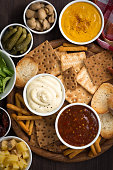 assortment delicious appetizers with different sauces, top view