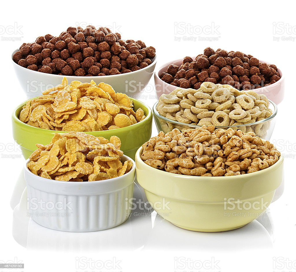 assortment dry cereal, flakes  for breakfast, isolated on white stock photo