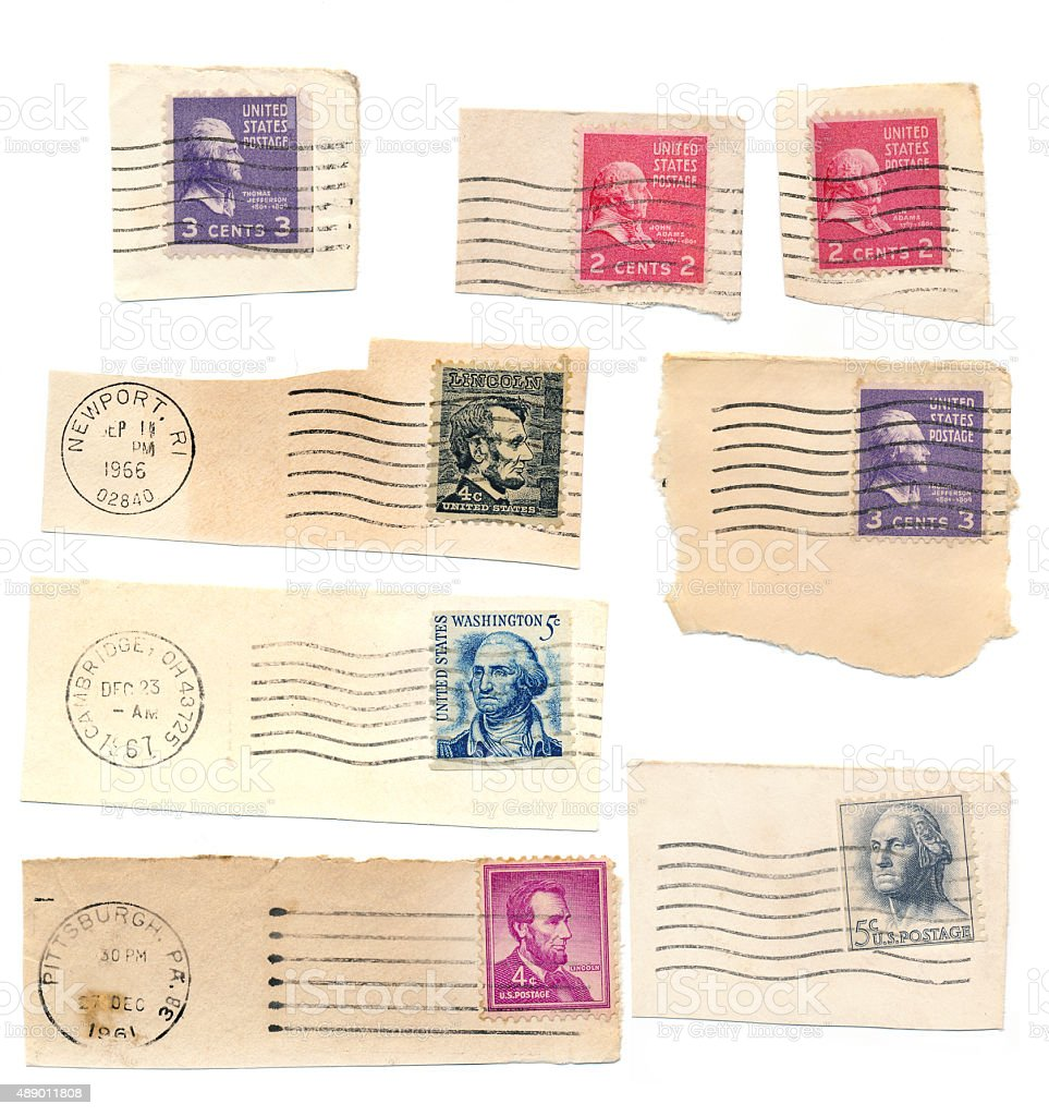Assortment of aged vintage USA postage stamps stock photo