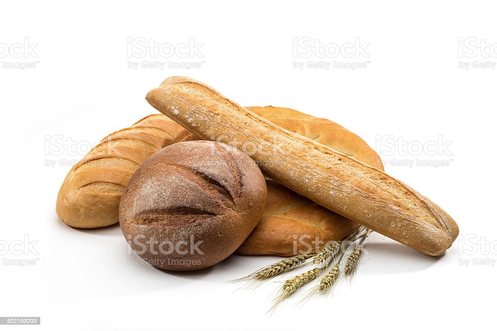 assortment of baked bread in basket on white background stock photo