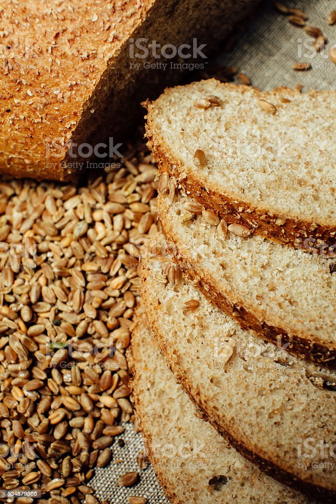 Assortment of baked bread on wood table stock photo