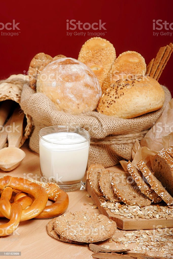 Assortment of baked breads and prezells with yoghurt royalty-free stock photo