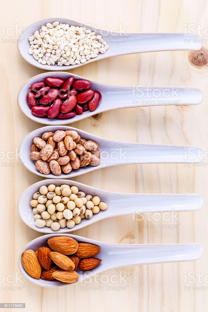 Assortment of beans and lentils in ceramic spoon . stock photo