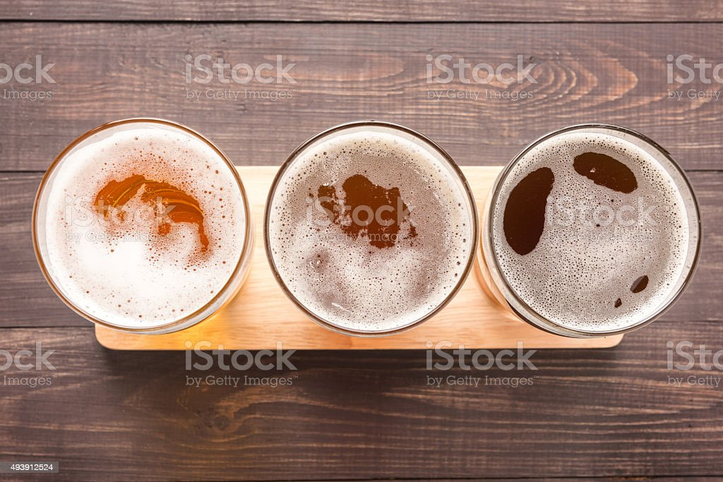 Assortment of beer glasses on a wooden background. Top view stock photo