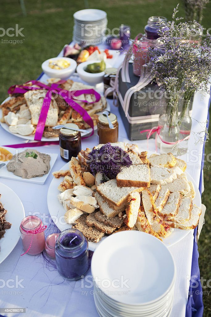 Assortment of bread and condiments on table at a wedding royalty-free stock photo