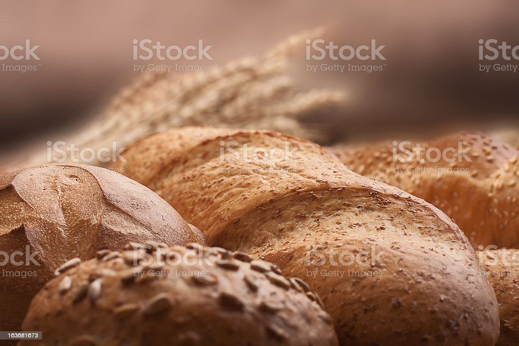 Assortment of breads and ears bunch still life royalty-free stock photo