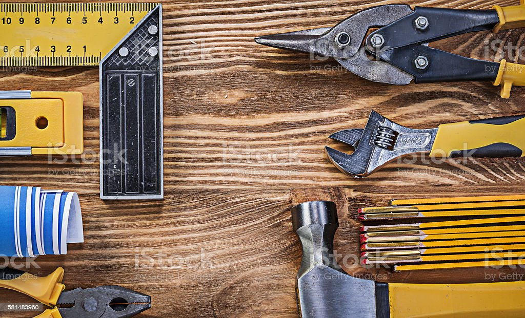 Assortment of building equipment on vintage wooden board directl stock photo
