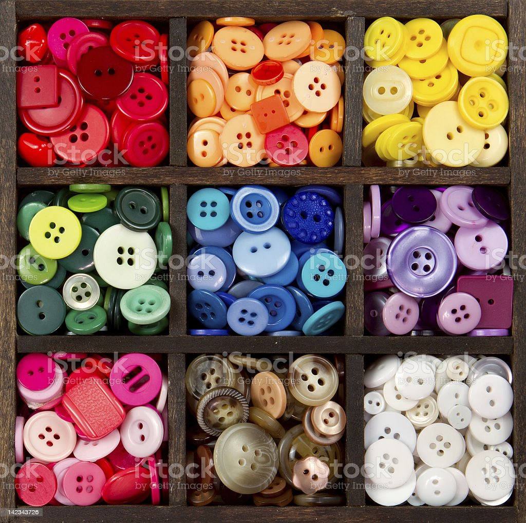assortment of buttons arranged by color stock photo