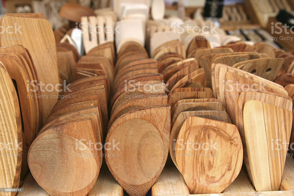 Assortment of carved wooden spoons stock photo