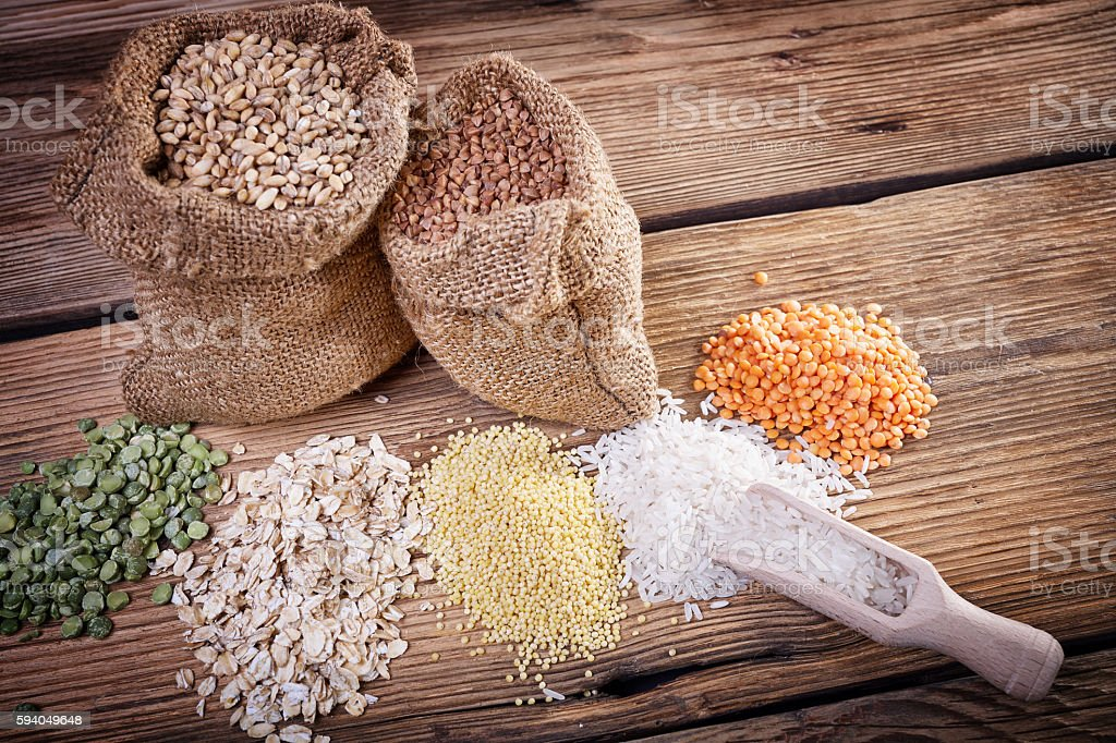 Assortment of cereals on a wooden table stock photo