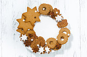 assortment of Christmas cookies on a white plate, top view