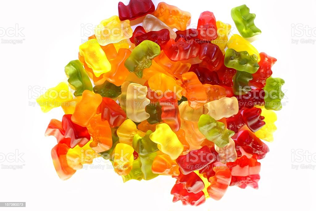 Assortment of colorful fruity Gummy Bears isolated on white background stock photo