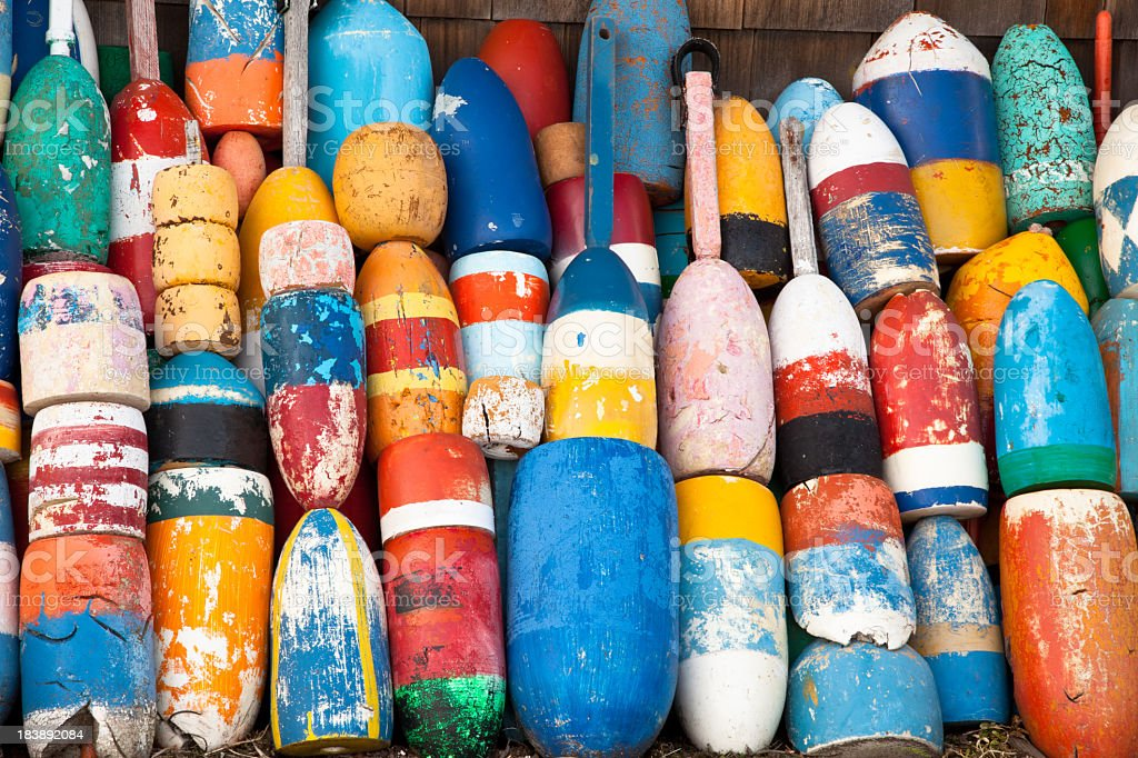 Assortment of colorful lobster buoys stock photo