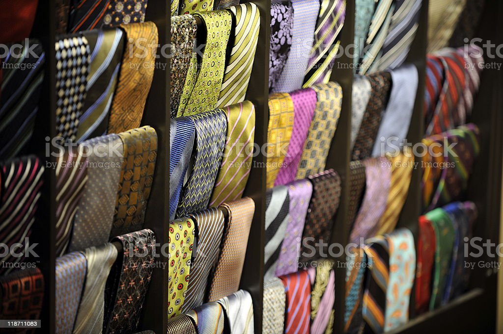 Assortment of colorful men's ties hanging on a display rack stock photo