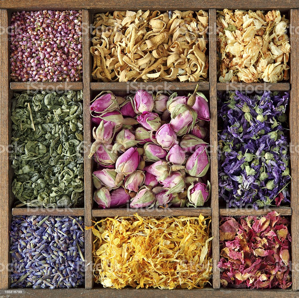 Assortment of dried tea in wooden box stock photo