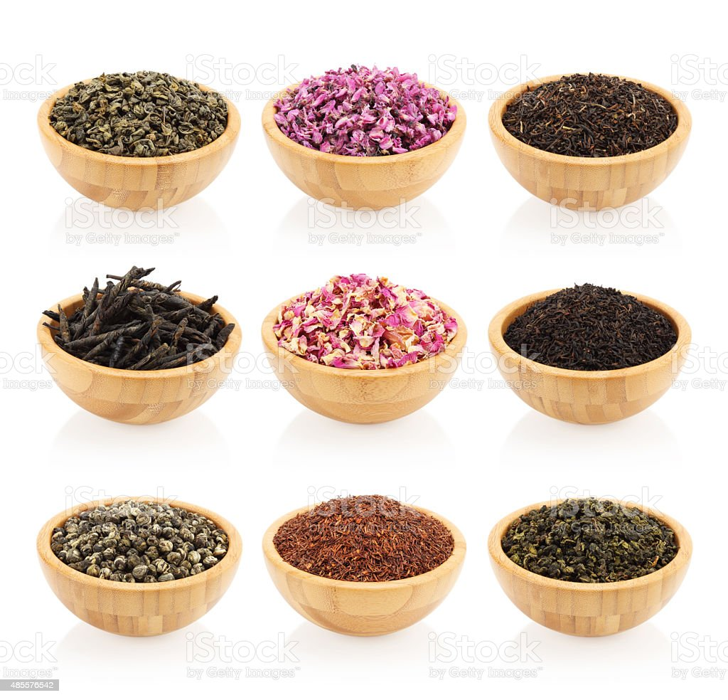 Assortment of dry tea in wooden bowls stock photo