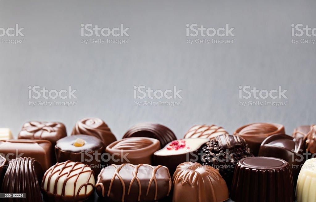 Assortment of fine candies, white, dark, milk chocolate Sweets background stock photo