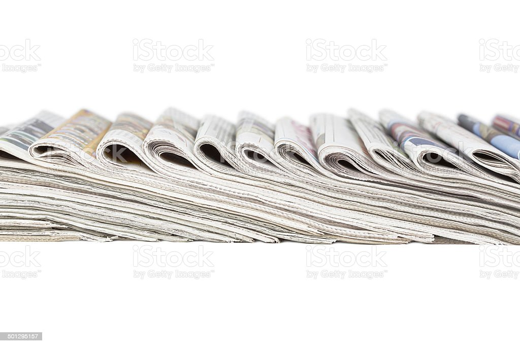 Assortment of folded newspapers stock photo