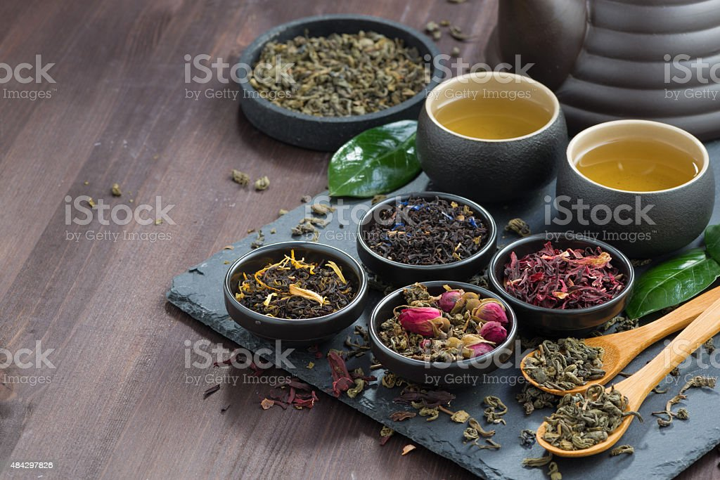 assortment of fragrant dried teas and green tea stock photo