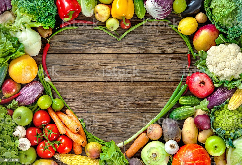 Assortment of  fresh fruist and vegetables in heart shape stock photo