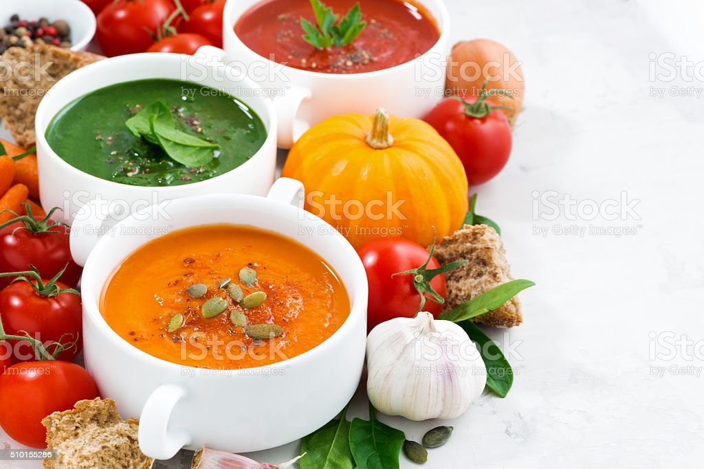 assortment of fresh vegetable cream soups and ingredients stock photo