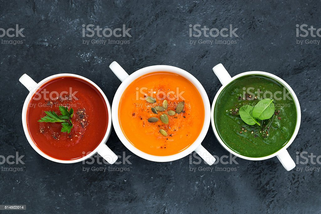 assortment of fresh vegetable soup on a dark background stock photo