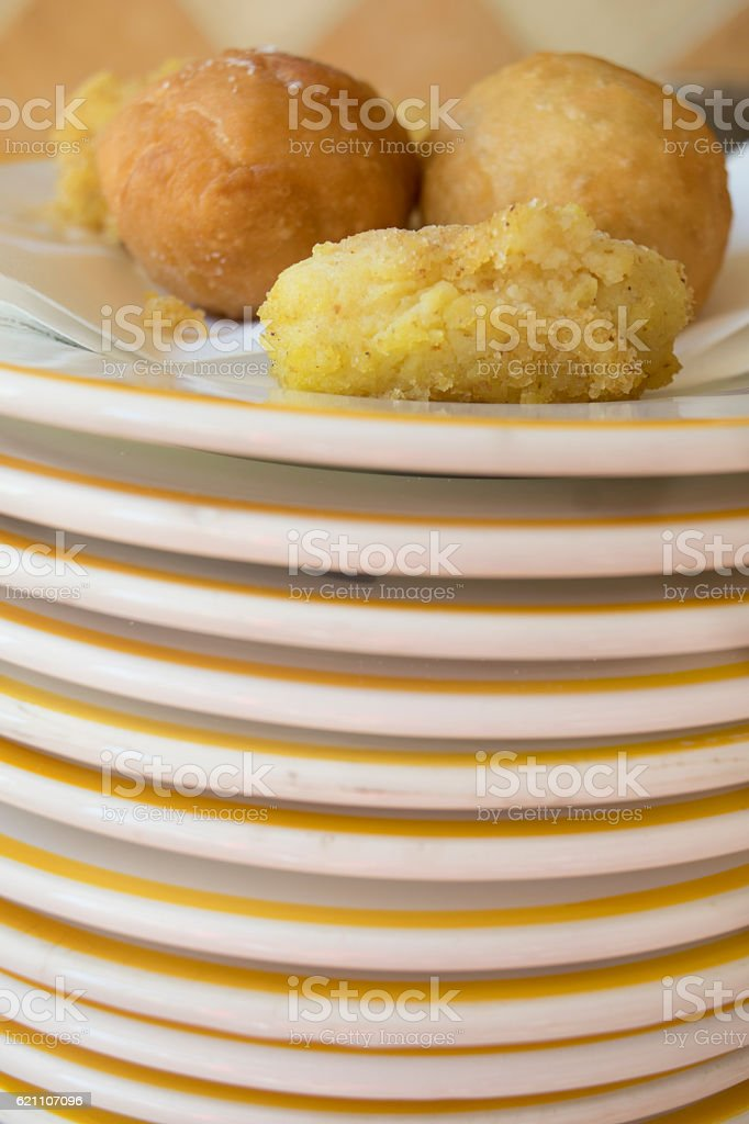 assortment of fry on a pile of dishes stock photo