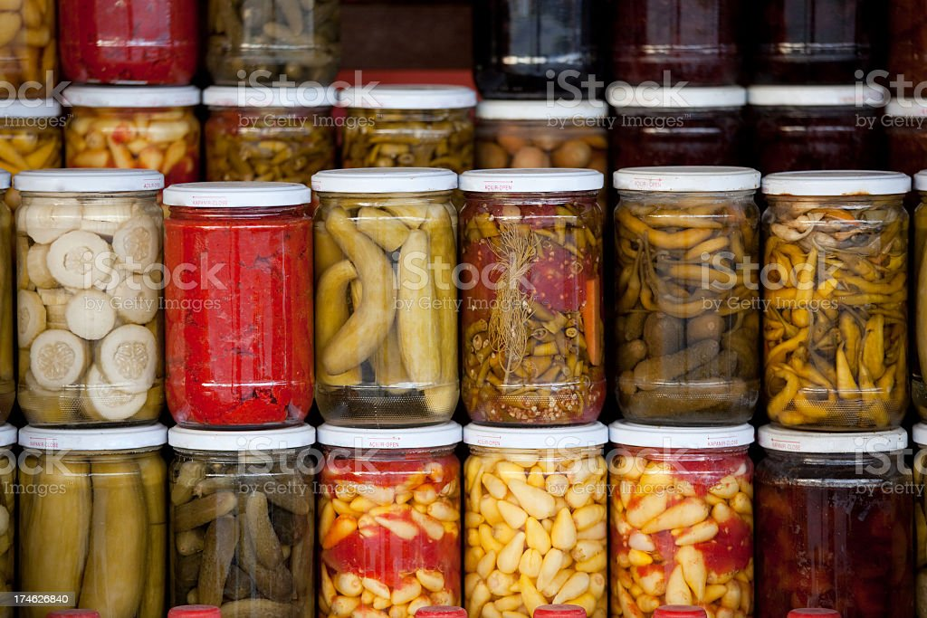 Assortment of glass jars filled with pickled vegetables stock photo